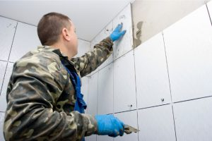 Hillsboro Bathroom Tile Installation by worker with gloves on