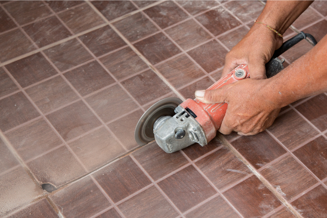 Hillsboro Tile Repair by employee with power grinder
