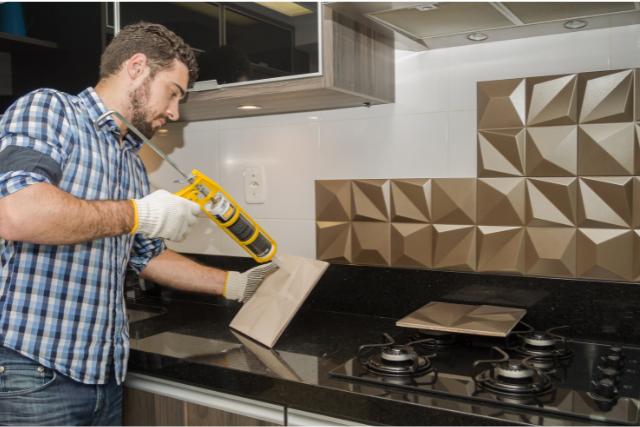 Kitchen Backsplash Installation by worker